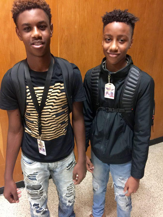 Akhwari Smith, 8th grader and his friend Kamden Ross, 8th grader, are keep up with the latest trends but still stay within the Dobie Junior High dress code requirements. The holes in their jeans are layered over other clothing.