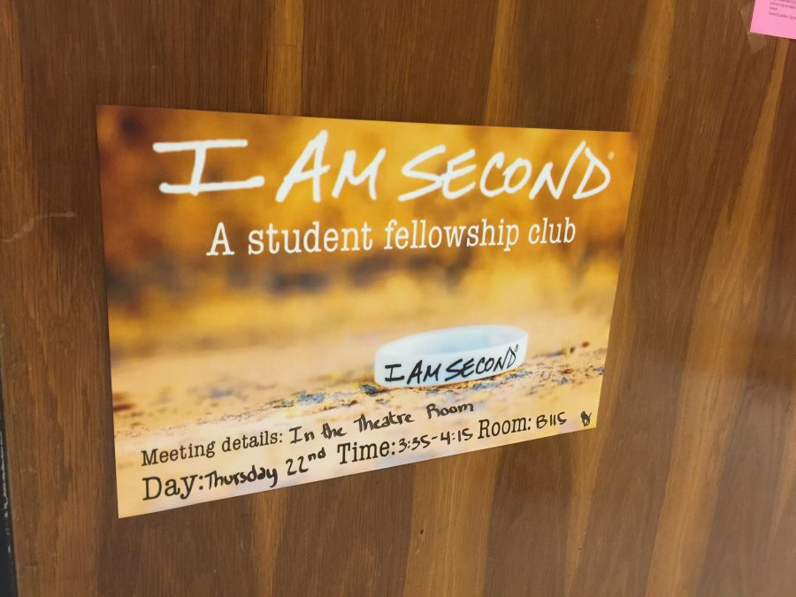 I am Second sign in the hallway invites students to join.