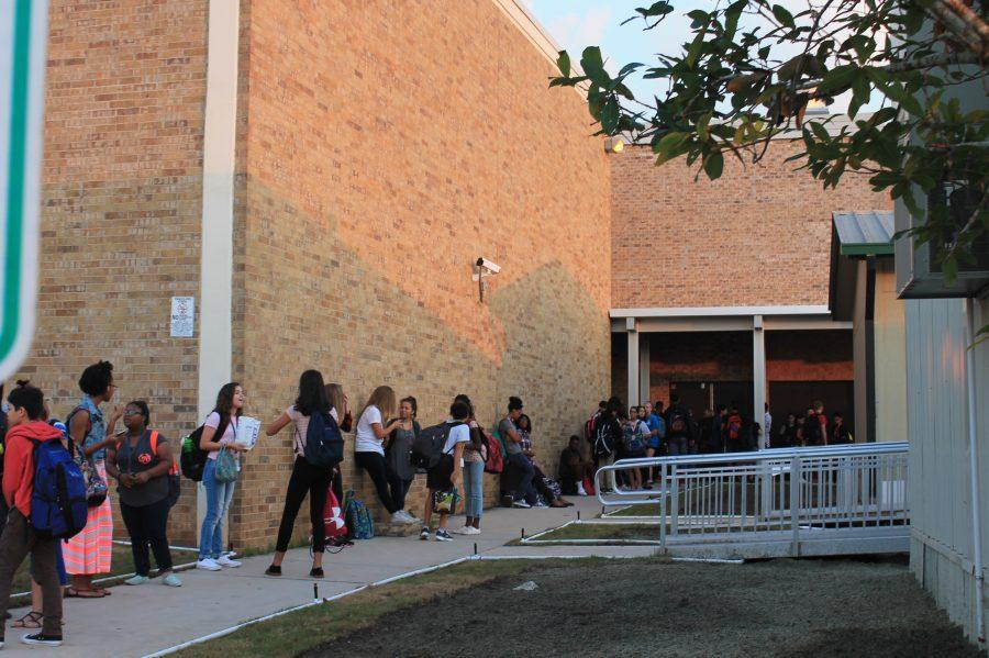 Students+wait+for+school+to+open+during+the+first+week+at+Dobie.