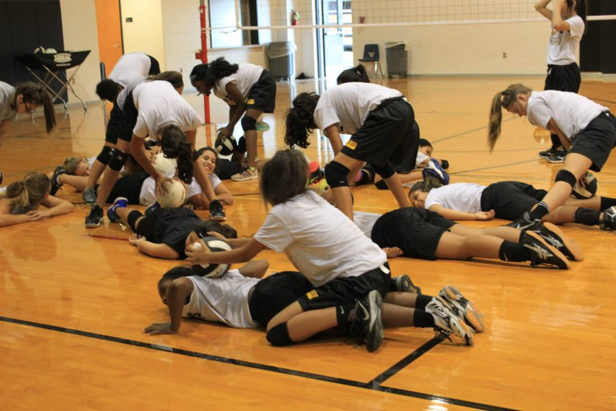 Girls do stretching exercises during athletics. Athletes know they are subject to OFI's.