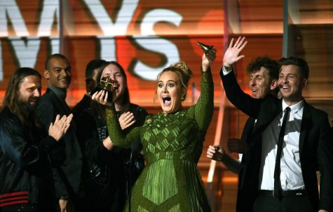 Adele at the 2017 Grammys breaking her award for Beyonce.