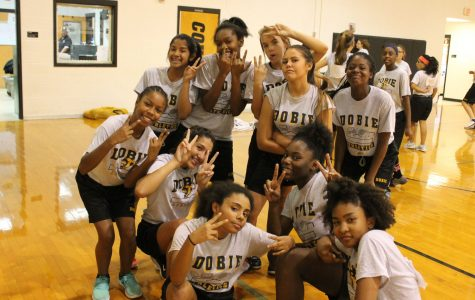 Girls pause during tryouts for a quick photo.