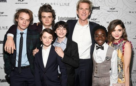 The cast of Stranger ThingsCharlie Heaton, Joe Keery, Noah Schnapp, Finn Wolfhard, Matthew Modine, Caleb McLaughlin and Natalie Dyer pose for a picture in their fancy clothing in LA.