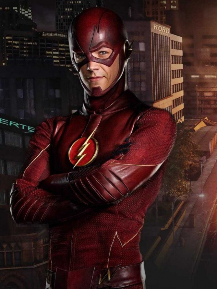 Barry Allen poses in his Flash uniform in front of Central City. The Flash has kept the city safe (on t.v. of course) since 2014.