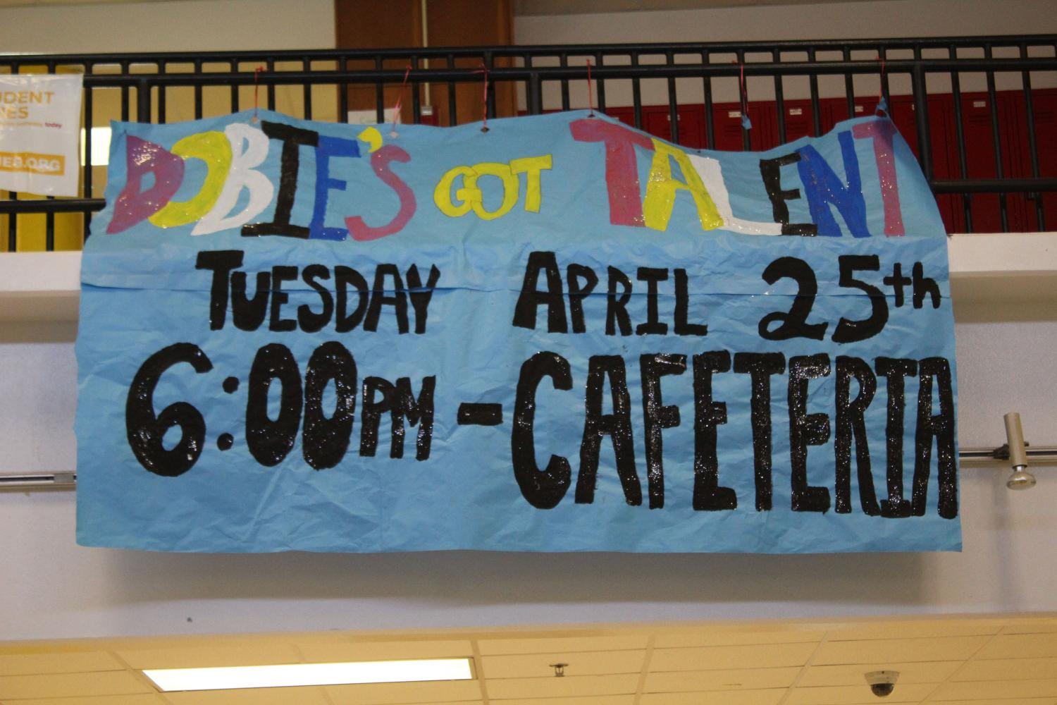 A sign about the talent show in the cafeteria.