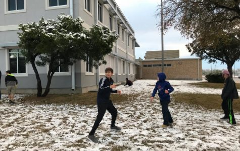 Dobie students play the morning after it snowed.
