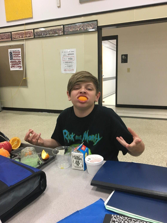Dean Slater, an 8th grader enjoying his lunch
