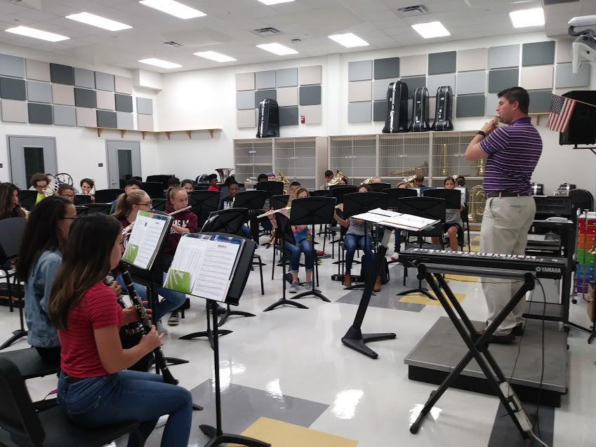 Band director playing with the class