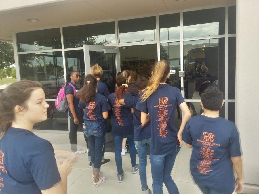 Students entering the CATERPILLAR workshop