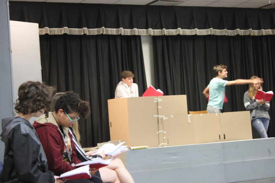 The Actors practice their lines while doing a run through of the show