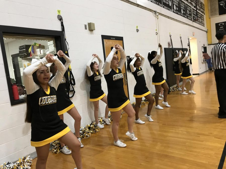 Dobie Cheerleaders pep up the crowd at a December girls basketball game.