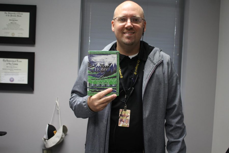 "Mr. Jackson with his book The Hobbit.    Mr. Jackson, a Dobie administrator, said, ""It gives you a better understanding of the world around you."" He agrees that reading also develops the reader's vocabulary."