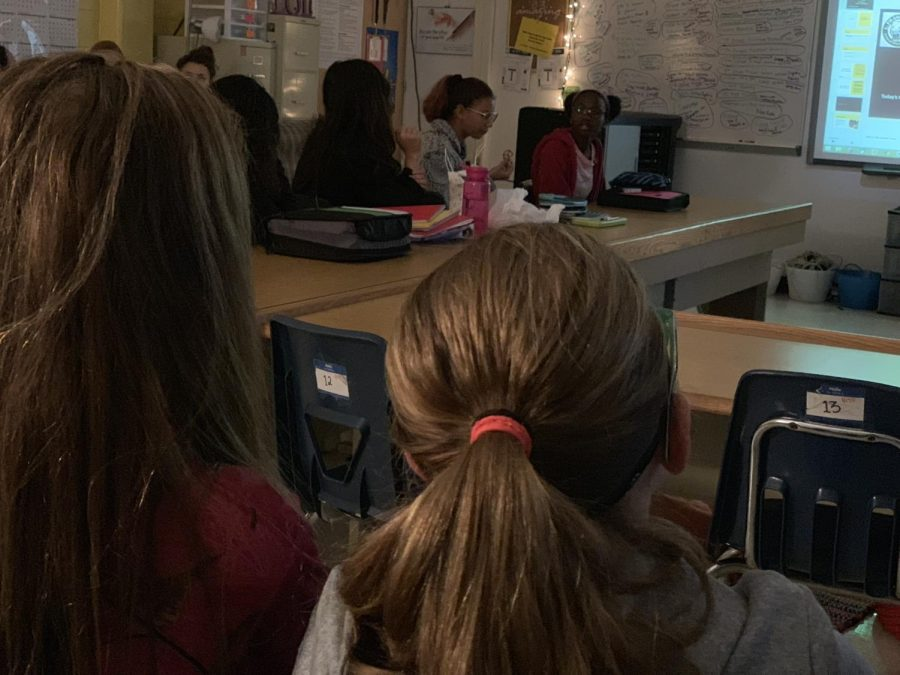 This photo shows two students being engaged with the presentation in front of them.