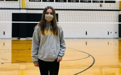 Genevieve Cox tried out for the volleyball team.