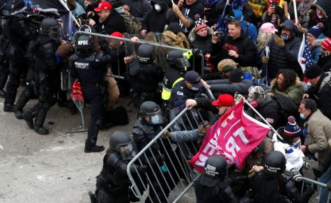 Pro-Trump protesters attempt to tear down a police barricade during a rally to contest the certification of the 2020 U.S. presidential election results by the U.S. Congress, at the U.S. Capitol Building in Washington, U.S, January 6, 2021. REUTERS/Shannon Stapleton