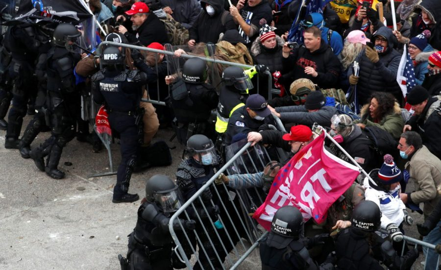 Pro-Trump+protesters+attempt+to+tear+down+a+police+barricade+during+a+rally+to+contest+the+certification+of+the+2020+U.S.+presidential+election+results+by+the+U.S.+Congress%2C+at+the+U.S.+Capitol+Building+in+Washington%2C+U.S%2C+January+6%2C+2021.+REUTERS%2FShannon+Stapleton